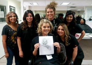 Vogue college students posing with drawing of Marilyn Monroe