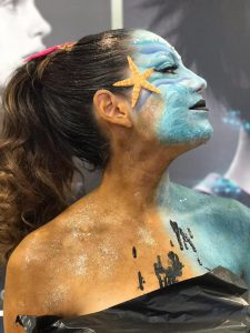 Woman with ocean themed body art